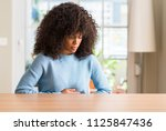 african american woman at home... | Shutterstock . vector #1125847436