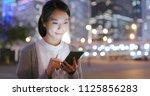 business woman look at smart... | Shutterstock . vector #1125856283