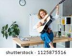 attractive businesswoman... | Shutterstock . vector #1125875516