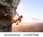 Young Man Climbing Vertical...