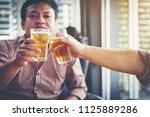 businessteam relaxing and... | Shutterstock . vector #1125889286