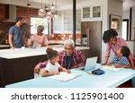 children doing homework in busy ... | Shutterstock . vector #1125901400