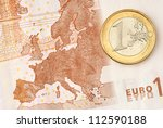 One Euro Coin On Euro Banknote...