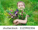 Happy Child Boy With Bouquet O...