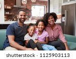 portrait of family relaxing on... | Shutterstock . vector #1125903113
