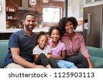 portrait of family relaxing on... | Shutterstock . vector #1125903113