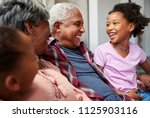 grandparents relaxing on sofa... | Shutterstock . vector #1125903116