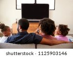 rear view of family with... | Shutterstock . vector #1125903146