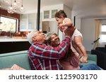 grandparents sitting on sofa... | Shutterstock . vector #1125903170