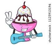 with guitar ice cream sundae... | Shutterstock .eps vector #1125913196