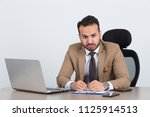 bored overworked businessman at ... | Shutterstock . vector #1125914513