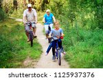 active senior couple with kids... | Shutterstock . vector #1125937376