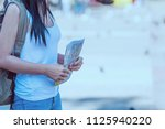 tourist travel woman looking at ... | Shutterstock . vector #1125940220