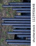 oil drill pipe. rusty drill... | Shutterstock . vector #1125950648