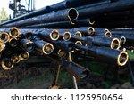 oil drill pipe. rusty drill... | Shutterstock . vector #1125950654