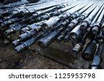 oil drill pipe. rusty drill... | Shutterstock . vector #1125953798