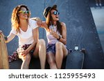 two female friends hangout at... | Shutterstock . vector #1125955493