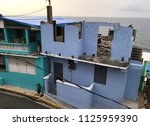 Small photo of Hurricane Season: Destruction of Abandoned Buildings Near the Coast; Weather, Safety First, Rebuilding the Community Ideas