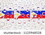 flags  of philippines behind a...   Shutterstock . vector #1125968528