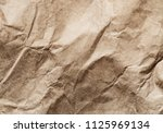 close up of crumpled recycled... | Shutterstock . vector #1125969134