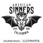 flying head of devil with bat... | Shutterstock .eps vector #1125984956
