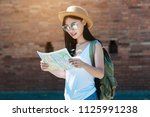tourist travel woman looking at ... | Shutterstock . vector #1125991238