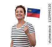liechtenstein flag. woman... | Shutterstock . vector #1125995120