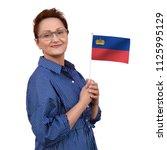 liechtenstein flag. woman...   Shutterstock . vector #1125995129