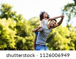 portrait of young father... | Shutterstock . vector #1126006949