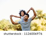 portrait of young father... | Shutterstock . vector #1126006976