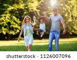 happy young couple spending... | Shutterstock . vector #1126007096