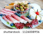 mixed cheese and meat antipasto ... | Shutterstock . vector #1126008956