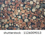 firewood prepared for fireplace ... | Shutterstock . vector #1126009013