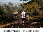 Small photo of Local residents carry water to extimguish a forest fire on eastern suburbs of Athens, Greece on July 17, 2015