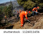 Small photo of Volunteer firefighters extinguish a forest fire on eastern suburbs of Athens, Greece on July 17, 2015