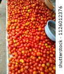 tomatoes at market | Shutterstock . vector #1126012376