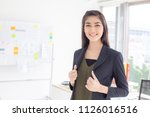 asian woman standing at modern...   Shutterstock . vector #1126016516