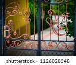 wrought iron gates  ornamental... | Shutterstock . vector #1126028348