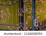 wrought iron gates  ornamental... | Shutterstock . vector #1126028354
