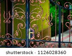 wrought iron gates  ornamental... | Shutterstock . vector #1126028360
