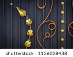 wrought iron gates  ornamental... | Shutterstock . vector #1126028438