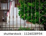 wrought iron gates  ornamental... | Shutterstock . vector #1126028954
