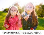 girls play with soap bubbles. | Shutterstock . vector #1126037090