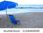one vibrant blue beach chairs... | Shutterstock . vector #1126060040