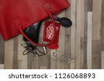 the red bag fell to the wooden... | Shutterstock . vector #1126068893