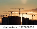 crane and building silhouettes... | Shutterstock . vector #1126080356