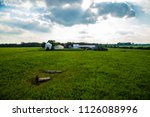 farm at sunset green field... | Shutterstock . vector #1126088996