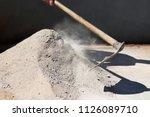 man makes cement mass with hoe  ... | Shutterstock . vector #1126089710