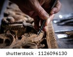 hands of craftsman carve with a ... | Shutterstock . vector #1126096130