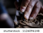 hands of craftsman carve with a ... | Shutterstock . vector #1126096148